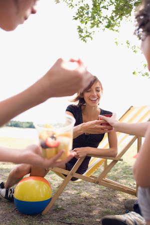 Germany Leipzig Ammelshainer See Friends having picnic near lake LANG_EVOIMAGES