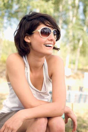 Germany Leipzig Ammelsrainer See Woman wearing sunglasses portrait