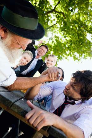 Germany Bavaria Upper Bavaria Two men in beergarden arm wrestling