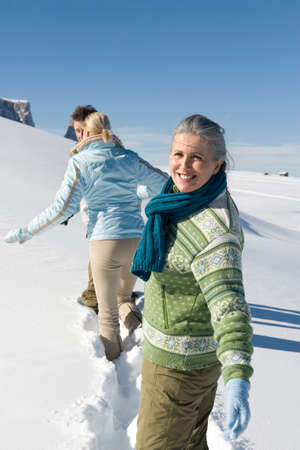 Italy South Tyrol Seiseralm Three Persons walking in snow
