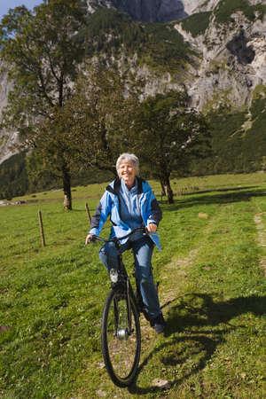 Austria Karwendel Senior woman biking LANG_EVOIMAGES