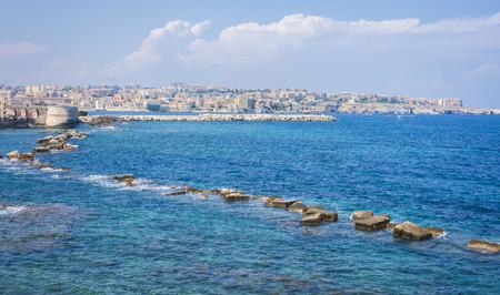 Rocky sea shore of Ortygia, Syracuse, Sicily, Italy
