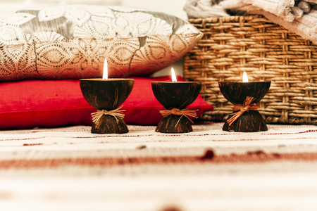 Burning spa aroma candles in coconut shell