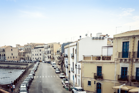 Old buildings in seafront of Ortygia (Ortigia) Island, Syracuse, traditional architecture of Sicily, Italy