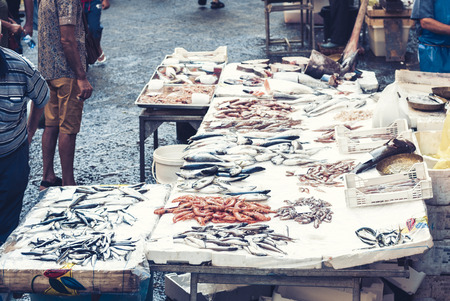 Fresh fish and seafood for sale in the fish market of Catania, Sicily, Italy