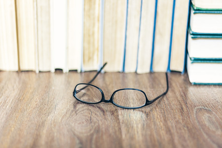 Stack of old book education concept background with glasses, many books piles with copy space for text 免版税图像