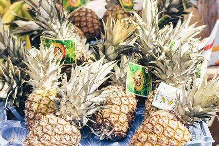 Catania, Sicily – august 08, 2018: pineapples in the fruit market, Catania, Sicily, Italy