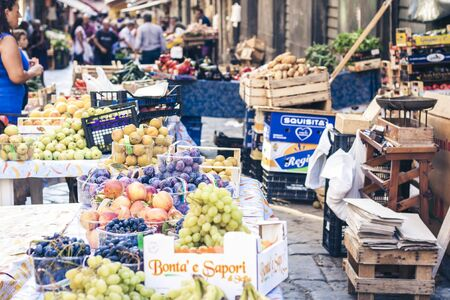 Catania, Sicily, Italy – august 11, 2018: various colorful fresh fruits in the fruit market Редакционное