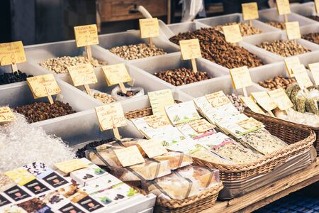 Catania, Sicily – august 16, 2018: dried fruits, spices and nuts in the fruit market Редакционное