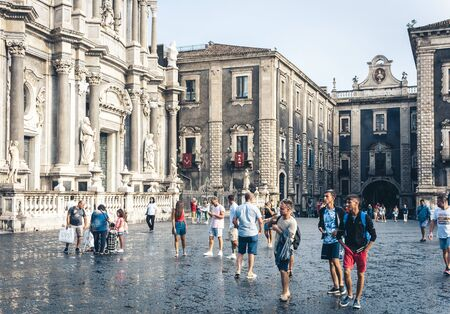 Catania, Sicily, Italy – august 15, 2018: people on the historical square of the city,  Piazza del Duomo near Cathedral dedicated to Santa Agatha