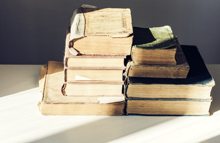 Stack of old books education retro concept background, many books piles with copy space for text. Foto de archivo