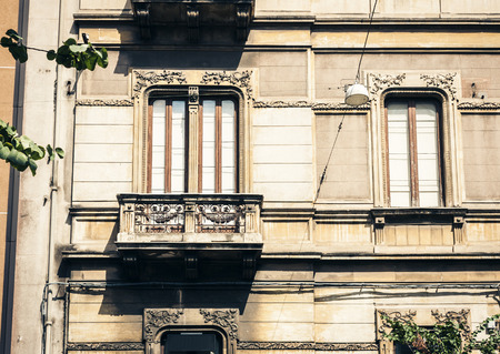balcony in old baroque building in Catania, traditional architecture of Sicily, Italy