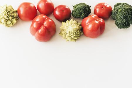 Plant based raw food seasonal vegetables background, vegan food cooking ingredients, top view Banco de Imagens