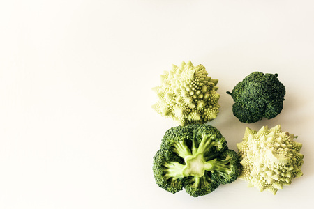 broccoli inflorescence and roman cauliflower and on white background isolated with space for text Banco de Imagens