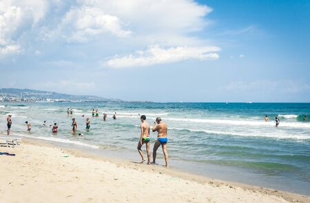 Catania, Sicily, Italy – august 15, 2018: people relax on the beach Lido Cled