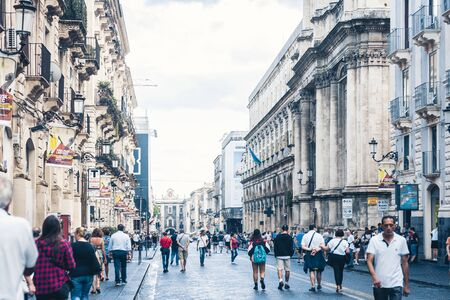 Catania, Sicily – august 15, 2018: people walk on historical street of Catania, Sicily, travel to Italy
