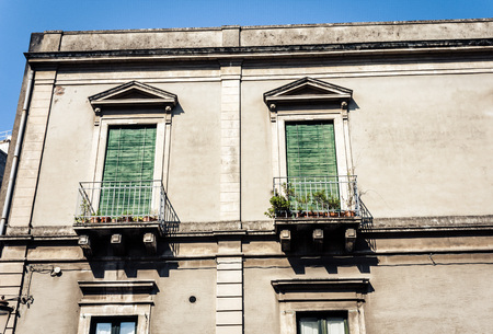 Decoration stucco of balcony in old baroque building in Catania, traditional architecture of Sicily, Italy