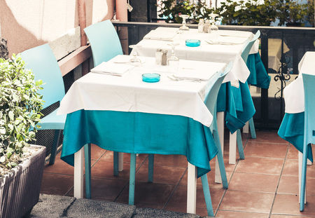 Serving on the table on terrace in the restaurant in Taormina, Sicily, Italy, setting for diner 스톡 콘텐츠