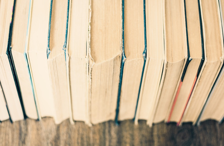 Stack of old book education concept background, many books piles with copy space for text