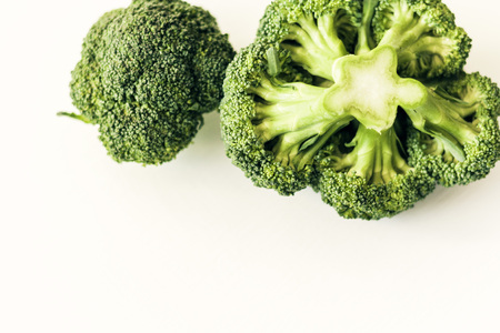Broccoli inflorescence on white background isolated with space for text