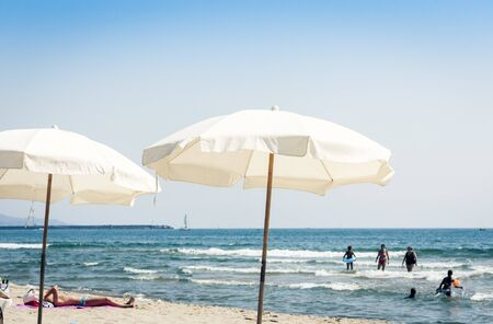 Catania, Sicily, Italy – august 11, 2018: people relax on the beach Lido Cled