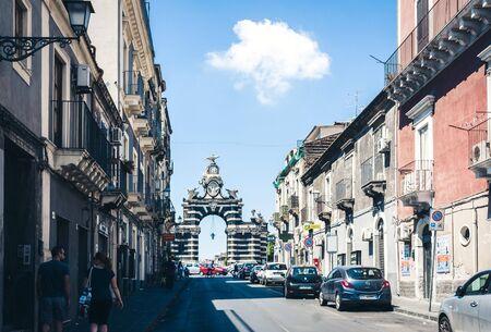 Catania, Sicily, Italy - august 16, 2018: street view of famous landmark - gate Porta Garibaldi