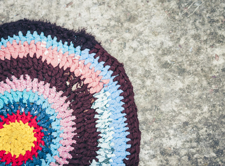 homemade door mat carpet colorful outside on the ground
