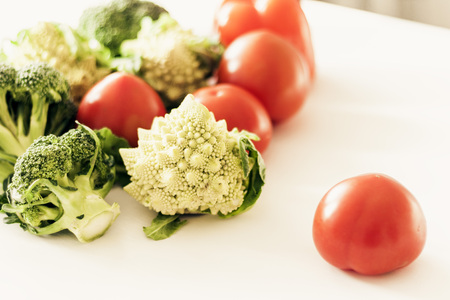 Vegetable variety on wooden white table. Selection of summer and autumn vegetables, space for text