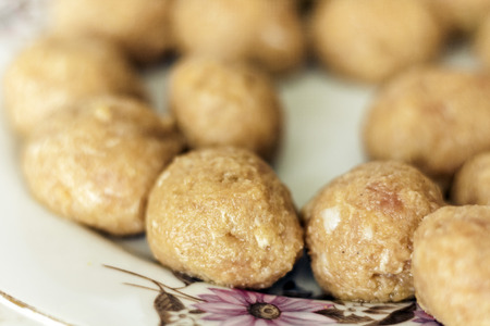 Preparing, cooking, making meatballs for homemade fried minced meat cutlets, traditional Ukrainian dish Stock Photo