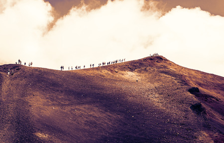 Sicily sunset, people walking on Mount Etna, active volcano Фото со стока