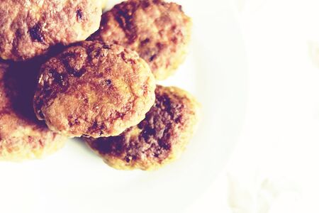 homemade fried minced meat cutlets on white plate, traditional Ukrainian dish
