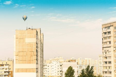 air balloons fly over residential buildings in Kiev, Ukraine