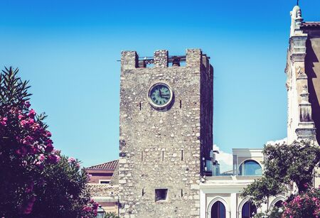 Facade wall of old baroque tower building houses in Taormina, traditional architecture of Sicily, Italy