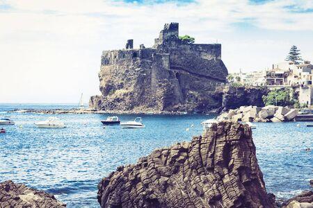 Acicastello – ancient norman castle in Acitrezza, Catania, Sicily, Italy Stock Photo