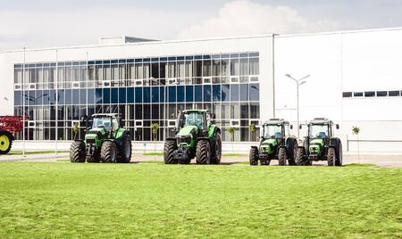 new tractors are standing next to the trading pavilion for sale in Kiev region, Ukraine