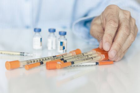 medical syringes for insulin for diabetes in woman hand