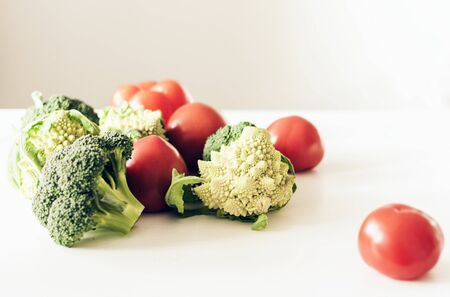 Ripe vegetables tomatoes romanesco broccoli on white wooden background with copy space for your text Zdjęcie Seryjne