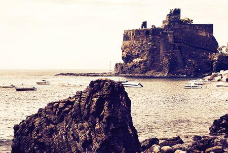 Acicastello – ancient norman castle in Acitrezza on sunset, Catania, Sicily, Italy Stockfoto