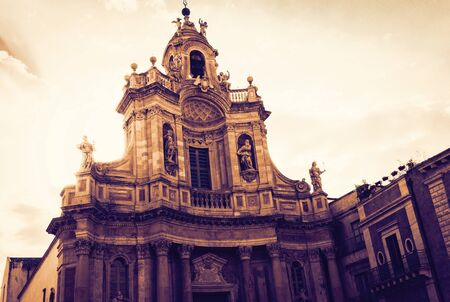 Beautiful cityscape of Italy on sunset, facade of old cathedral in Catania, Sicily, Basilica della Collegiata, famouse baroque church