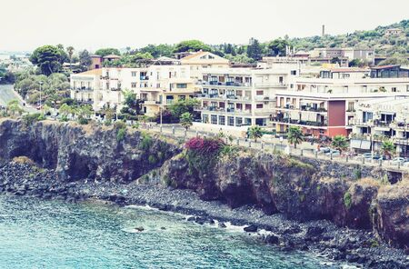 Travel to Italy -  aerial view of Acitrezza, Catania, Sicily, facade of old buildings on the seafront