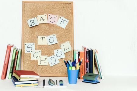 Notebooks piles, stack of books education back to school background, textbooks, glasses and pencils in holder with copy space for text Zdjęcie Seryjne
