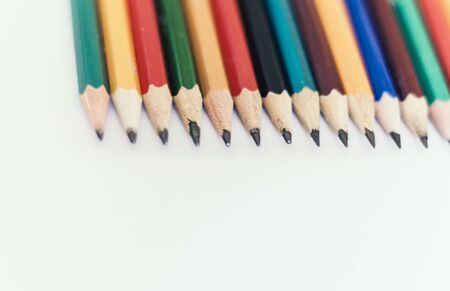 colored pencils on white table, back to school education concept background