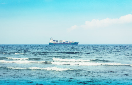 Catania, Sicily, Italy – august 11, 2018: beautiful seascape with cargo ship from coast