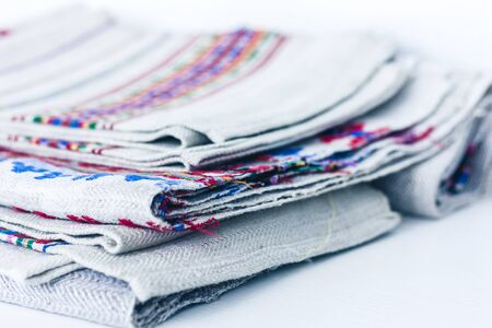A stack of woven linen towels with embroidery, traditional handmade in Ukraine Фото со стока - 133672405