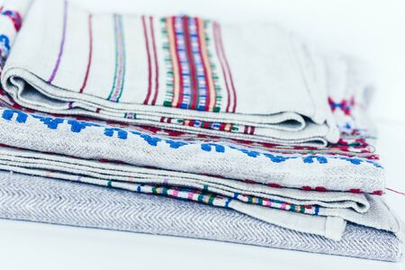 A stack of woven linen towels with embroidery, traditional handmade in Ukraine Фото со стока - 133672407