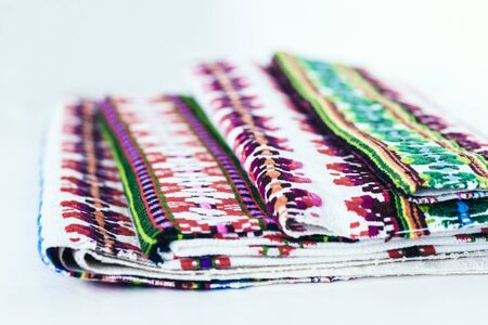 A stack of woven linen towels with embroidery, traditional handmade in Ukraine Standard-Bild - 133672408