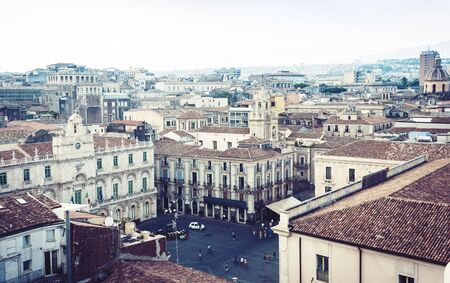 Catania, Sicily – august 08, 2018: aerial cityscape with traditional architecture, piazza dell'Universita, travel to Italy Редакционное