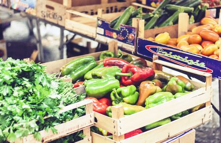Catania, Sicily – august 13, 2018: Various colorful fresh vegetables and greens in the fruit market