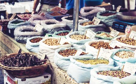 Catania, Sicily – august 16, 2018: dried fruits, spices and nuts in the fruit market, Catania, Sicily, Italy