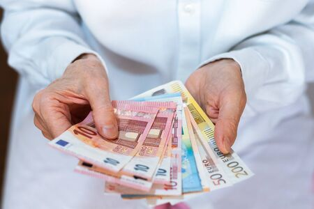 Female woman hand holds out a pack of euro close up, finance business concept Stock fotó